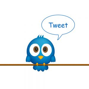 "Cartoon blue bird sitting on rope, singing - ""Tweet"" comes out of its mouth in a bubble. Keyword: Twitter"