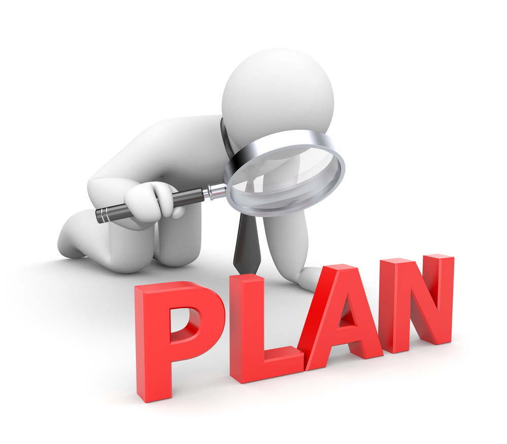 "White 3D figure with a black necktie examines the word ""Plan"" in large,  red, 3D block letters with a magnifying glass. Keyword: strategic planning"